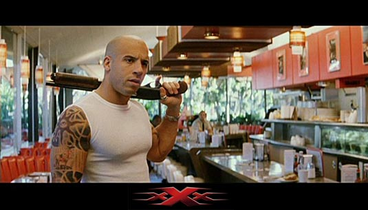 Vin Diesel holding a sawed-off Remington 870 shotgun as Xander Cage in XXX