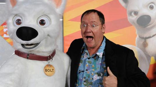 "John Lasseter, chief creative officer for Walt Disney and Pixar Animation Studios and executive producer of the animated film ""Bolt"" from Walt Disney Animation Studios, poses with the character Bolt at the film's premiere in Los Angeles on November 17, 2008."