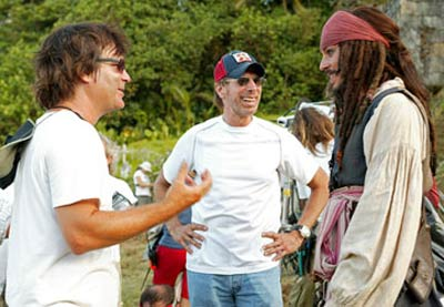 Gore Verbinski, Jerry Bruckheimer and Johnny Depp on the set of Pirates of the Caribbean