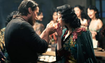 Christian Bale as John Miller and Ni Ni as Yu Mo in THE FLOWERS OF WAR